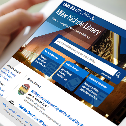 Person holds tablet to navigate home page of new UMKC Libraries website
